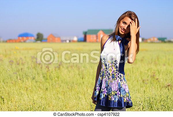 Beautiful girl in a field - csp4107922