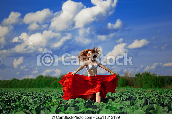 Beautiful girl in a field - csp11812139