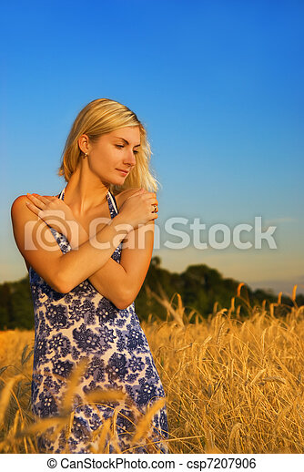 Beautiful girl in a wheat field - csp7207906