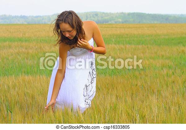 beautiful girl in a wheat field - csp16333805