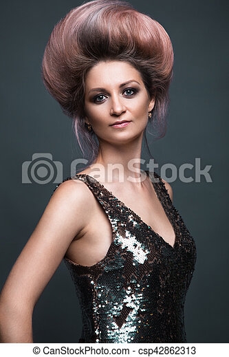 Beautiful girl in evening dress with avant-garde hairstyles. Beauty the  face.