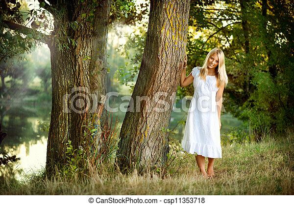 Beautiful girl in fairy forest near the river  - csp11353718