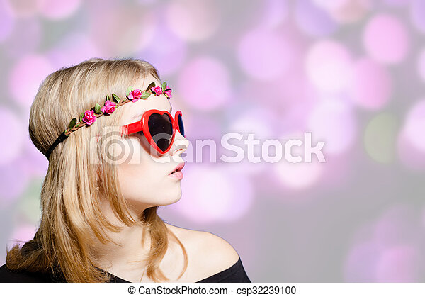 Beautiful girl in heart shaped sunglasses on bokeh background - csp32239100
