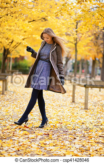 Beautiful girl in park on a fall day - csp41428046