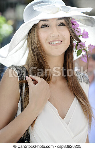 Beautiful girl in Positano on the Amalfi posing in the street with fashion clothes - csp33920225