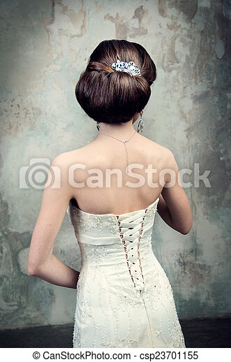 beautiful girl in the dress of the bride from the back - csp23701155