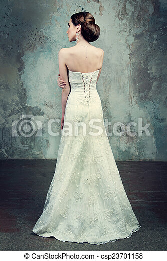 beautiful girl in the dress of the bride from the back - csp23701158