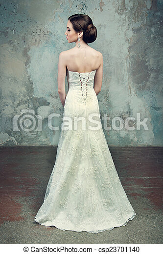 beautiful girl in the dress of the bride from the back - csp23701140