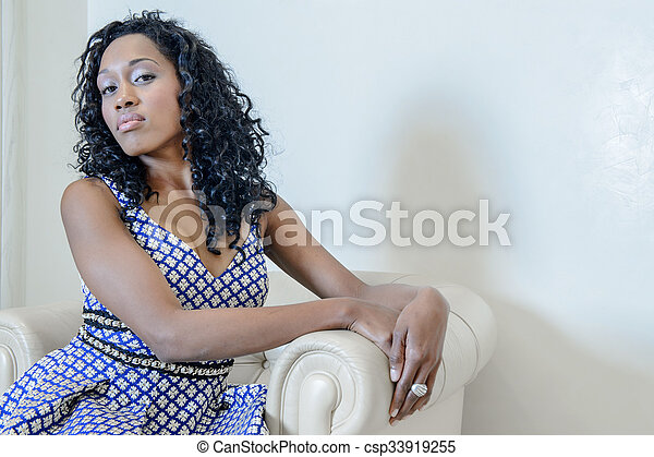 beautiful girl posing with blue dress - csp33919255
