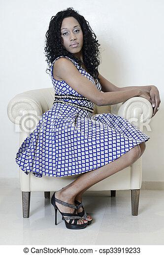 beautiful girl posing with blue dress - csp33919233