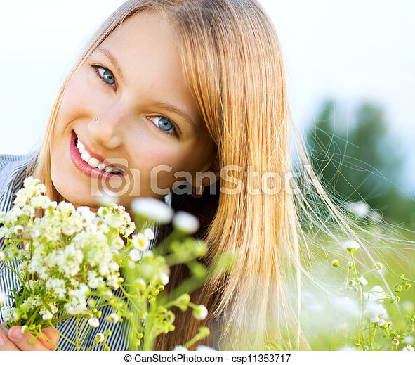 Beautiful Girl Relaxing outdoors. Happy and Smiling  - csp11353717