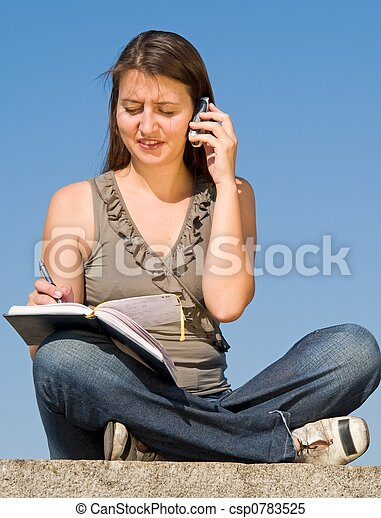 beautiful girl taking notes - csp0783525