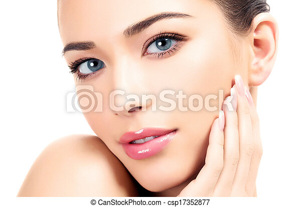 Beautiful girl with clean fresh skin, white background - csp17352877