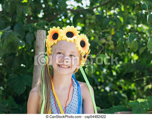Beautiful girl with floral decoration fun glances to the side. - csp54482422