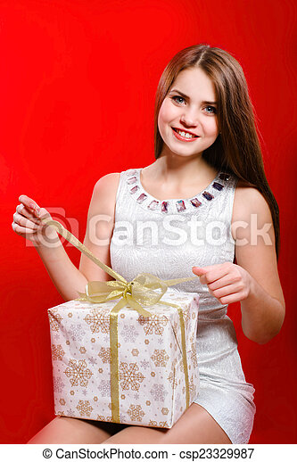 Beautiful girl with gift box - csp23329987
