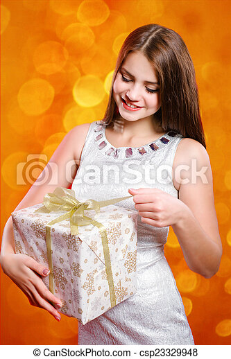Beautiful girl with gift box - csp23329948