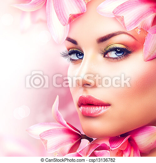 Beautiful Girl With Orchid Flowers. Beauty Woman Face  - csp13136782