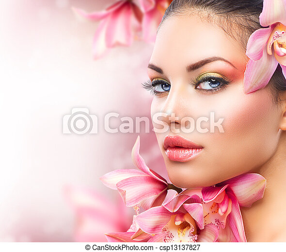 Beautiful Girl With Orchid Flowers. Beauty Woman Face - csp13137827
