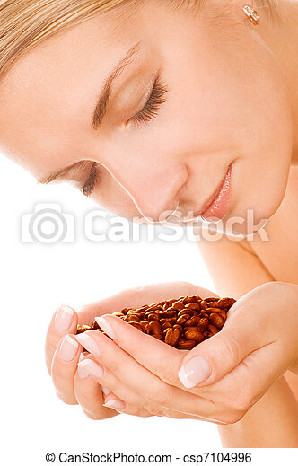 Beautiful girl with roasted coffee beans - csp7104996