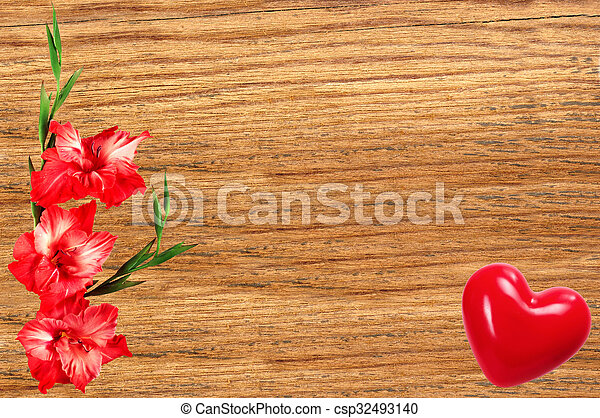 Beautiful gladiolus and red heart on wooden background - csp32493140