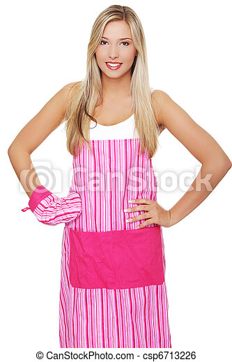 Beautiful happy young blond woman wearing kitchen apron - csp6713226