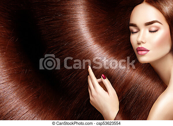 Beautiful healthy hair. Beauty woman with long brown hair as background - csp53623554