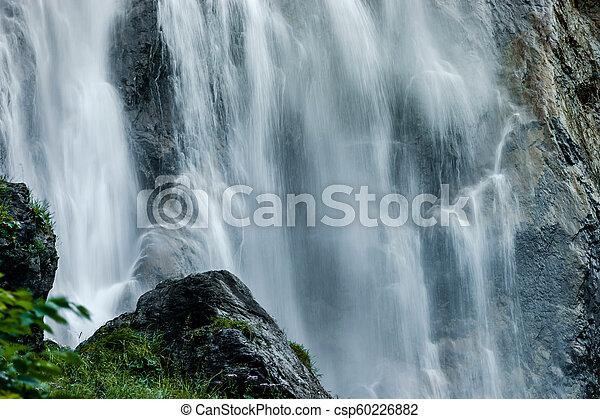 Beautiful high waterfall in swiss Alps, summer - csp60226882