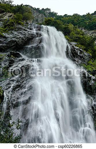 Beautiful high waterfall in swiss Alps, summer - csp60226865