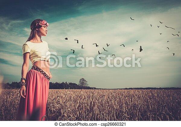 Beautiful hippie girl in a field - csp26660321