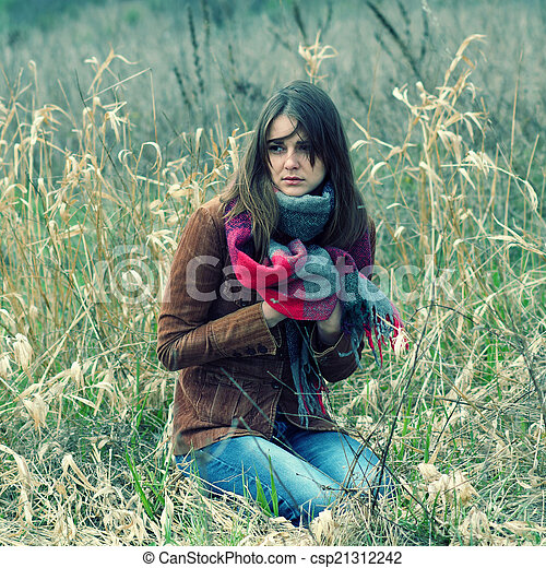 beautiful hipster girl in a field - csp21312242