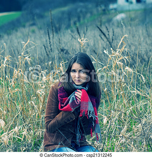 beautiful hipster girl in a field - csp21312245
