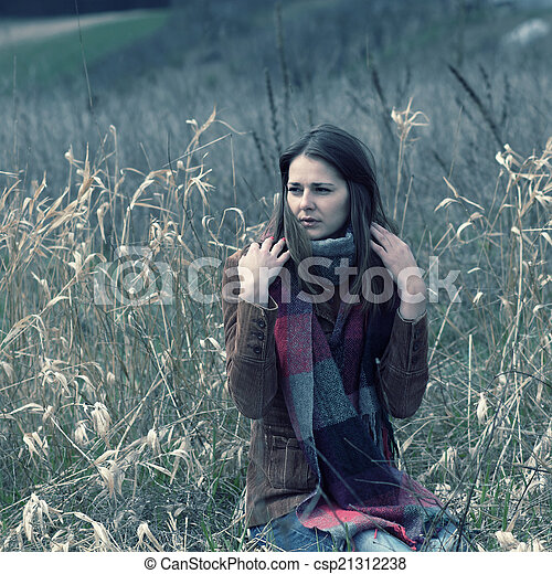 beautiful hipster girl in a field - csp21312238