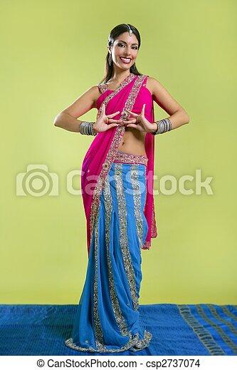 Beautiful indian young brunette woman dancing - csp2737074