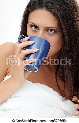 Beautiful lady is drinking coffee - csp5736654