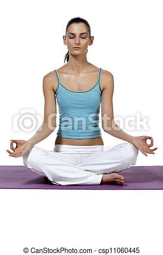 beautiful lady meditating over the mat - csp11060445