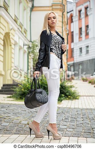 Beautiful lady posing on the street - csp80496706