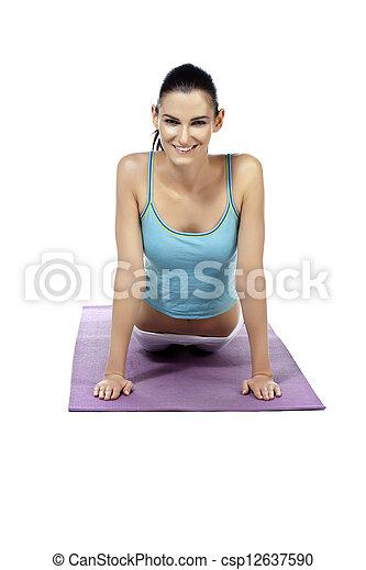 beautiful lady practicing yoga exercise - csp12637590