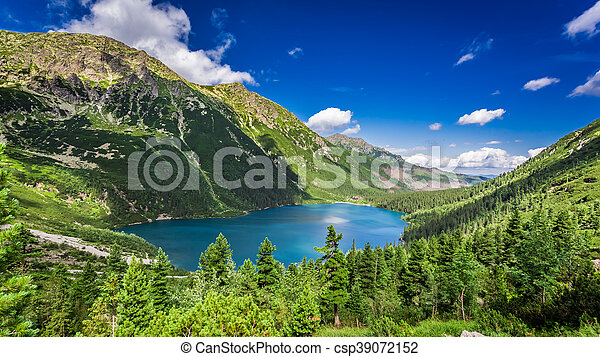 Beautiful lake in the middle of the mountains at sunrise - csp39072152
