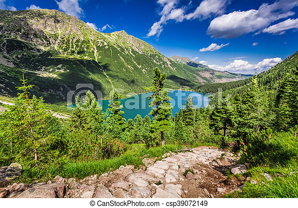 Beautiful lake in the middle of the mountains at summer - csp39072149