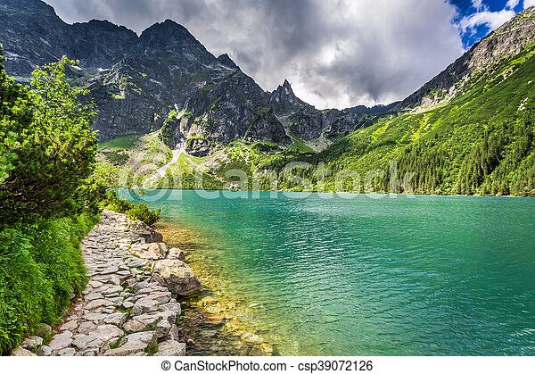 Beautiful lake in the mountains at sunrise - csp39072126