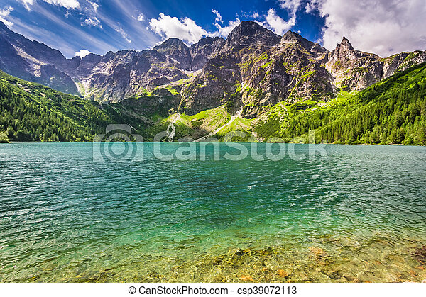 Beautiful lake in the Tatra Mountains at sunrise - csp39072113