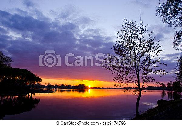 beautiful lake sunset in spring time - csp9174796