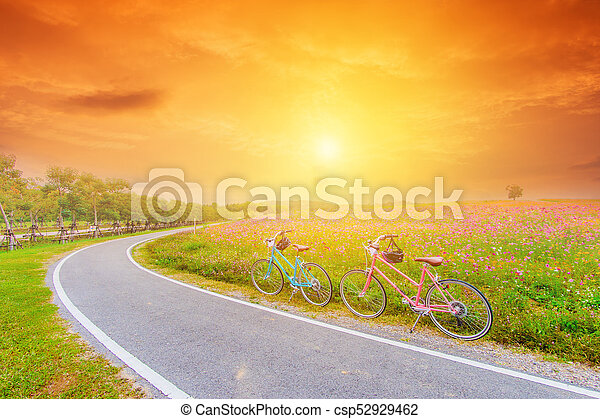 beautiful landscape image with bicycles at sunset - csp52929462