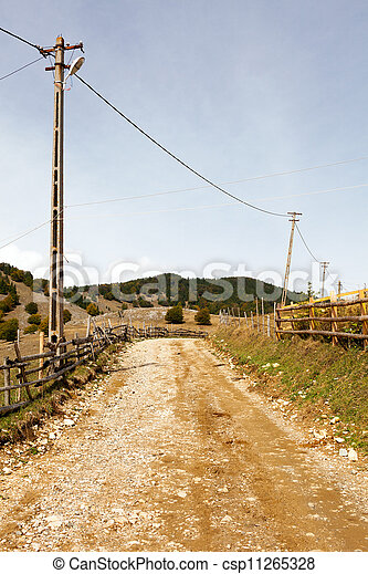 Beautiful landscape of a rural road in a mountain village - csp11265328