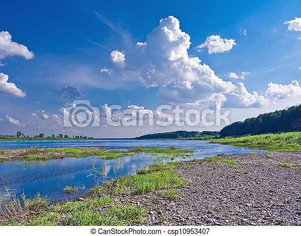 Beautiful landscape with a river on a sunny day - csp10953407