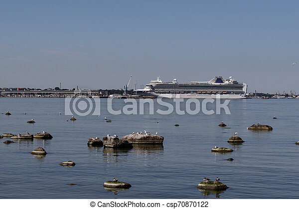 Beautiful landscape with sea view. Cruise liner in the sea at the pier of Tallinn old town - csp70870122