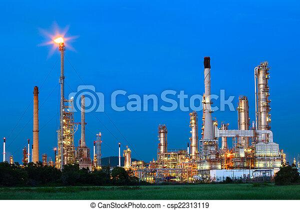 beautiful lighting of oil refinery palnt against dusky blue sky  - csp22313119