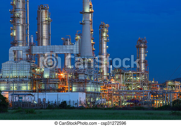 beautiful lighting of oil refinery palnt against dusky blue sky of oil refinery plant in heavy petrochemical industry estate  - csp31272596