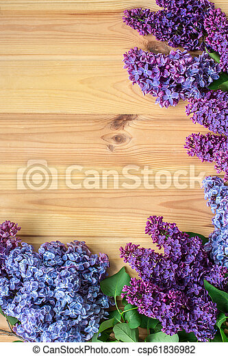 Beautiful lilac on a wooden background - csp61836982