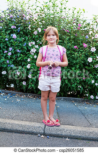 Beautiful little girl going to school outdoors - csp26051585